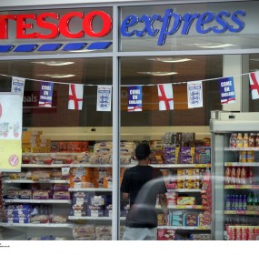 Tesco's profit slide in home market