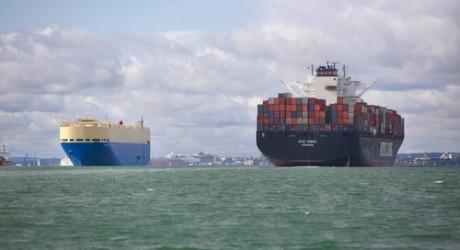 Cargo ships sailing into Southampton port